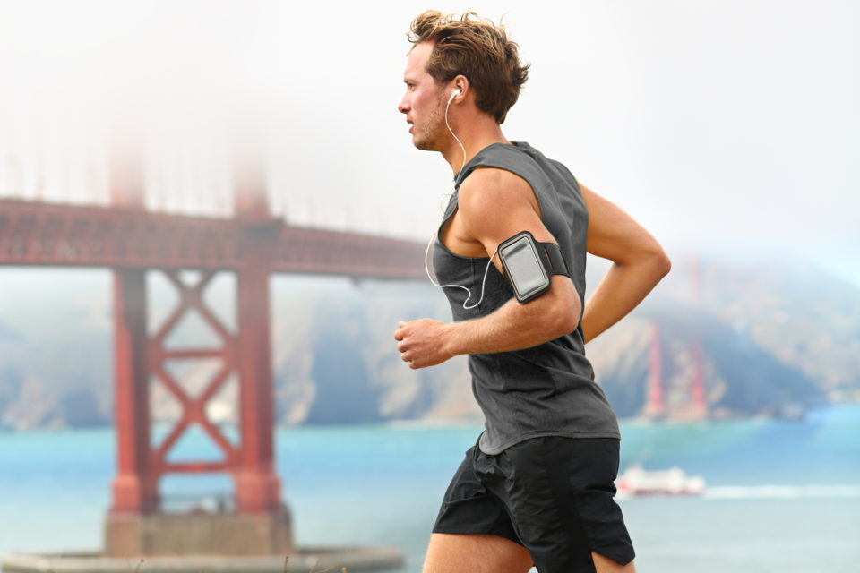 A man runs in front of San Francisco's Golden Gate bridge